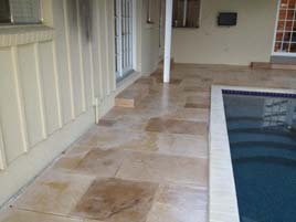 Beige Stamp Overlay Pool Deck accented with Water Based Stain