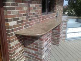 Outdoor Kitchen with a Concrete Bar Countertop