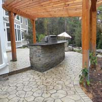 Exterior of Dream Home Enhanced by Stamped Concrete Surroundings