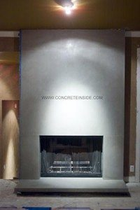 Architectural Accents - Facades Concrete gray polished stone fireplace surround in showroom using GFRC