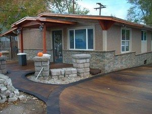 Rock Gray and beige faux stacked stone in exterior residential wall coating using Wall Stamp