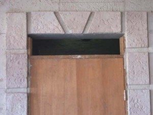 Light beige tarnished carved stone door trim in interior residential using Wall Stamp