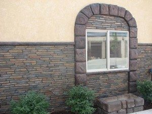 Rock Brown and beige stacked stone wall carving in commercial exterior walls using Wall Stamp