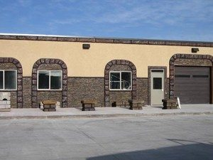 Rock Beige yellow faux stucco wall coating in exterior retail center using Wall Spray