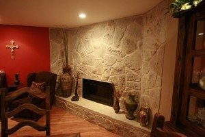 Light gray random carved stone fireplace surround in interior residential using Wall Stamp