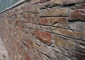Rock Orange brown carved stone wall in exterior residential using Wall Stamp