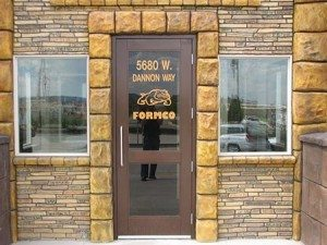 Rock Yellow gray carved stone wall accents in exterior retail using Wall Stamp
