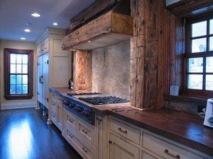 Brown distressed carved wood wall trim in interior residential kitchen using XS Precast and Eco-Stain