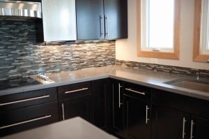 Large Kitchen Concrete Countertop with Glass Tile Backslash