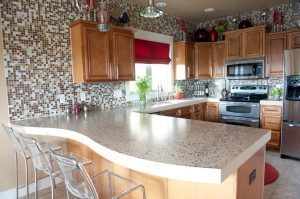 Clean Tan Concrete Countertop with Overhang with Colored Aggregate