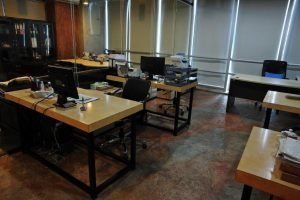 Office building Concrete desks Stained Tan with High Gloss Sealer