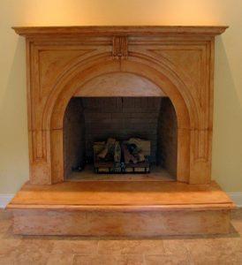 Dark Tan Stain Concrete Fireplace Surround