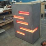 Hostess Stand Made out of Concrete with Orange LED Accent Lighting