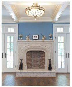Very Large White Concrete Fireplace in a formal room