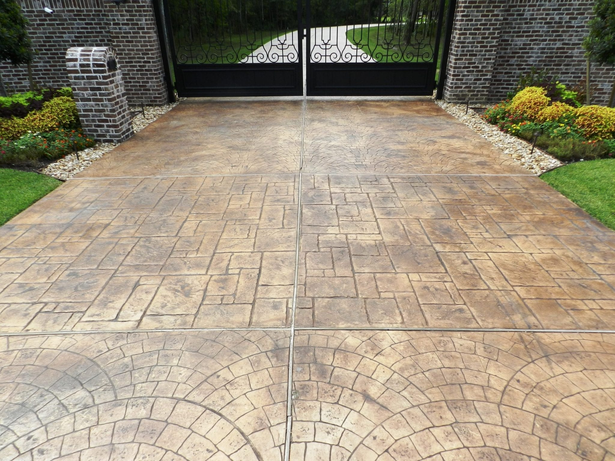 brown stained driveway stamped concrete