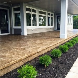 brown stained front concrete porch