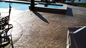 dark brown concrete pool deck stained with espresso stain