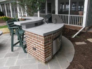 Rounded Concrete Countertop with raised bar