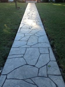 long gray concrete sidewalk stained with eco-stain