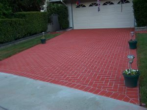 red stained brick driveway