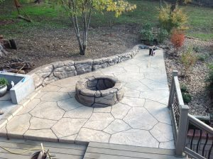 stained light brown stamped firepit patio
