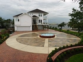 small circular stamped concrete driveway water feature