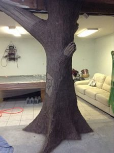 small artist carved concrete tree sculpture