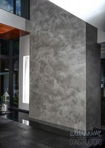 small burnished concrete wall water feature
