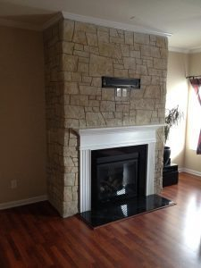 carved stacked stone fire place face