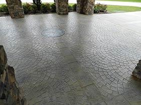 small circular brick stamped medallion car port