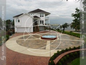 circular stamped concrete driveway water feature