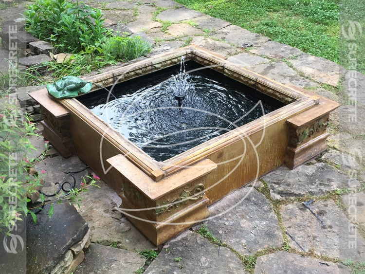 Cast concrete pond water feature for Concrete koi pond design