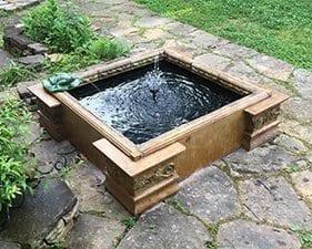 small concrete fountain koi pond design