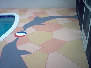 custom thin concrete dolphin pool deck