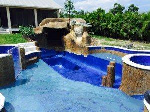 custom tropical concrete pool slide