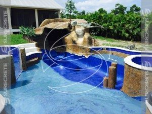 custom tropical concrete pool slide with rocks