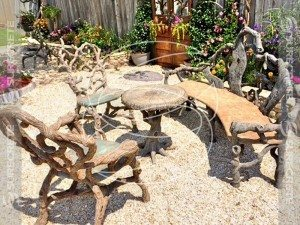 tree branch cast concrete chairs table benches