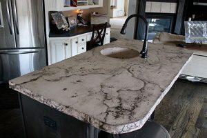 veined distressed concrete island sink