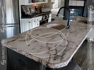 veined distressed concrete island sink
