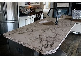 small veined distressed concrete island sink