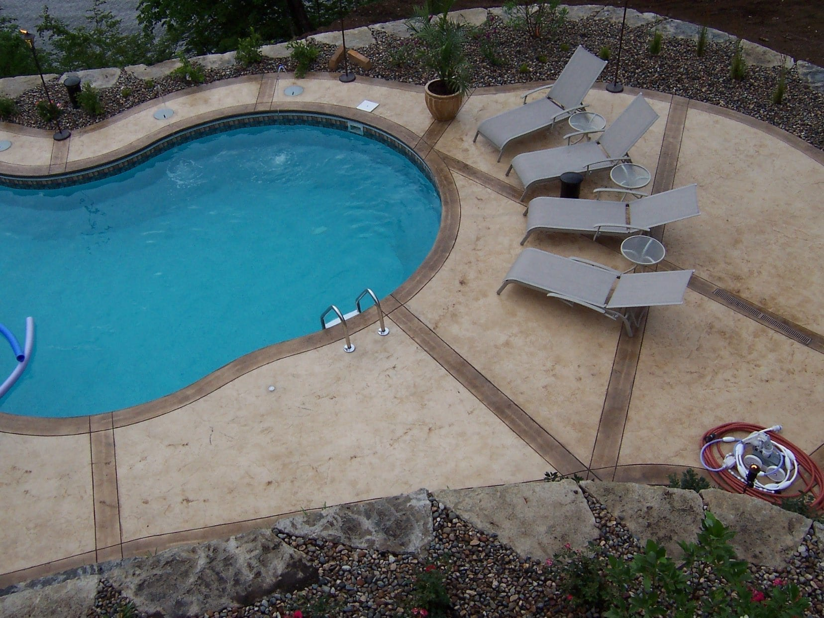 Stamped concrete pool surrounds with scenic lake view for Concrete pool