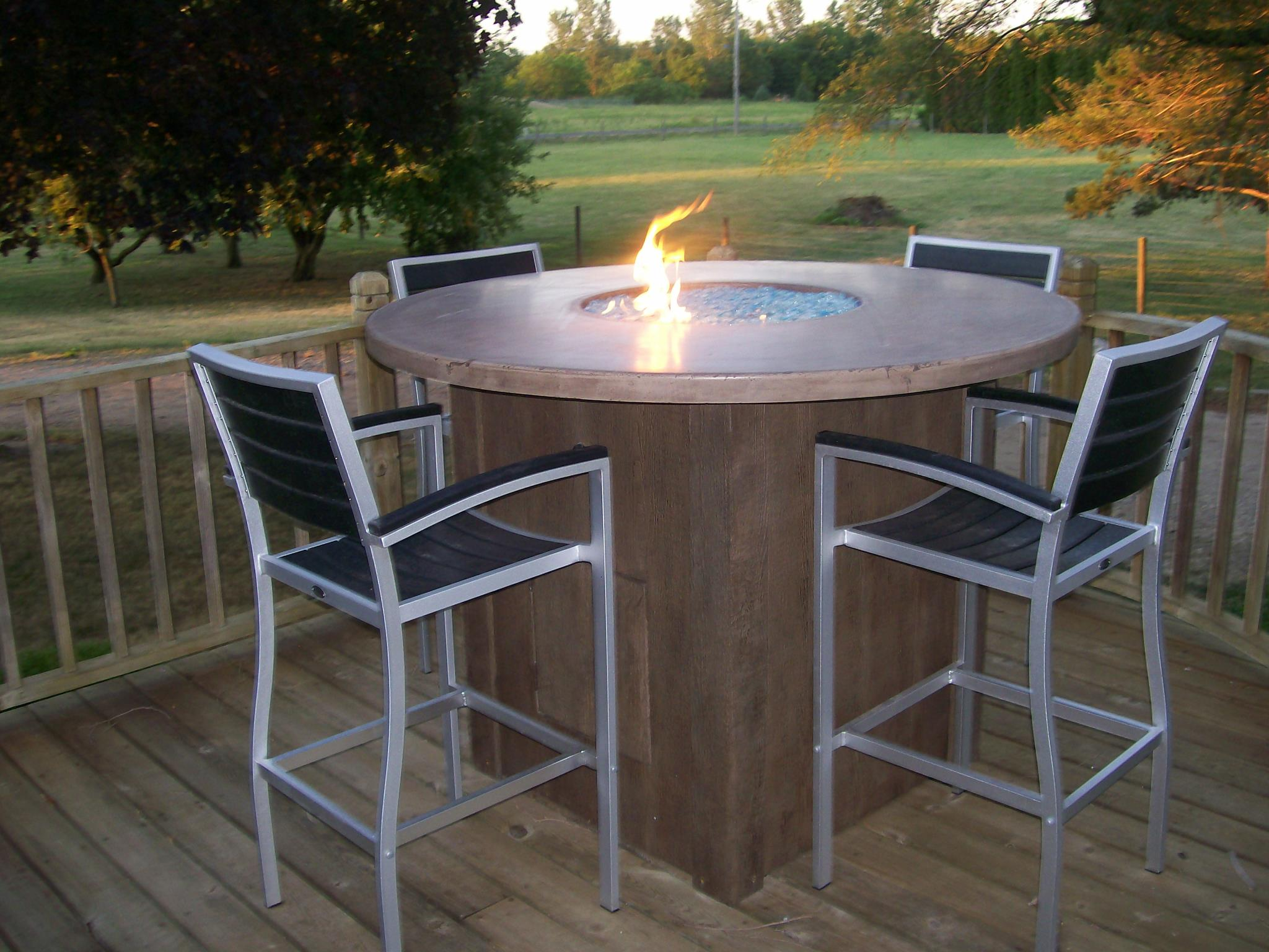 concrete table with fire pit and wooden like base