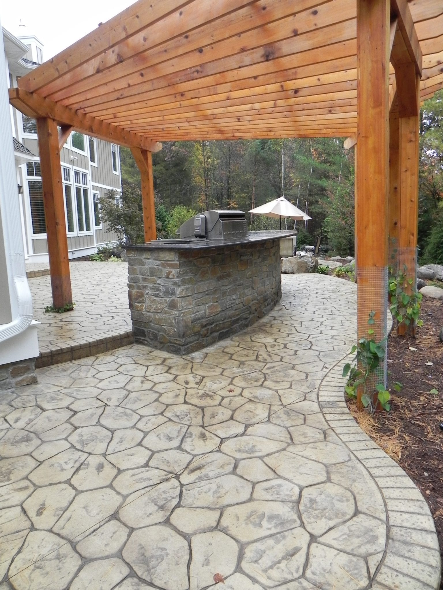 White Natural Stone Stamped Concrete Surroundings