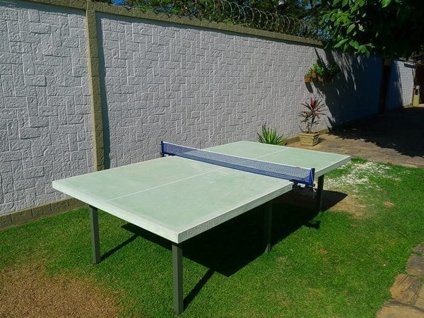 Captivating Outdoor Green Concrete Ping Pong Table