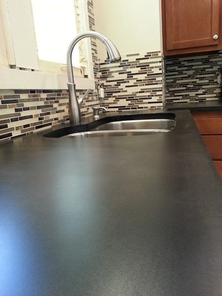 Solid Charcoal Concrete Counter Top with Backsplash