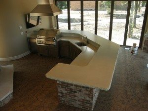 White Rock Face Concrete Counter with Brick Base