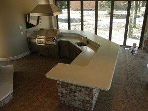 White Rock Face Concrete Counter with Brick Base