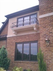 Custom Built Tan Balcony Floor with Brick Walls