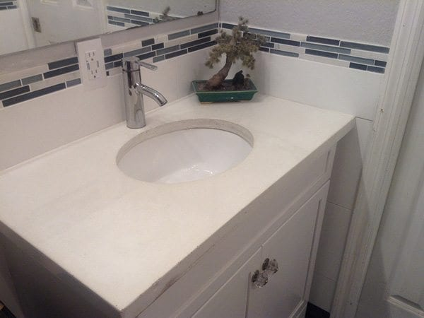 Simple White Bathroom Concrete Counter Top