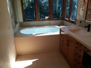 Tan Concrete Bath Tub Surround with Vanity Top and Integral Sink
